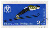 Ski jumper on post stamp — Stock Photo