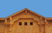 Pediment of new log cottage — Stock Photo