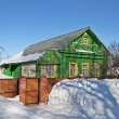 Green wooden house in winter — Stock Photo