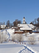 Winter country landscape with a church — ストック写真