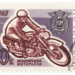 Stock Photo: Racing motorcyclist on post stamp