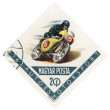 Riding motorcyclist on post stamp — Stock Photo #26285425