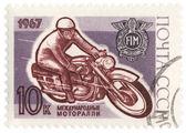 Racing motorradfahrer auf briefmarke der post — Stockfoto