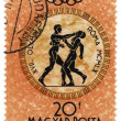 Two boxers in antique style on post stamp — Stock Photo