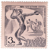 Discus thrower on post stamp — Stock Photo
