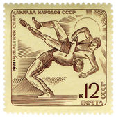 Wrestling on post stamp — Stock Photo