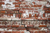 Old cracked red brick wall texture — Stock Photo