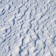 Uneven snow surface texture — Stock Photo
