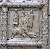 Bas-relief on ancient bronze gate — Stock Photo