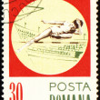 High jump on post stamp — Stock Photo #6347279