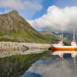Small fishing boat in the harbor of the fjord — Stock Photo