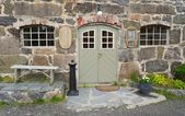 Entrance to the old stone tavern — Stock Photo