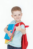 Boy with books on a white background — Stockfoto