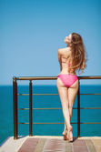 Long haired girl in bikini on tropical beach — Foto Stock