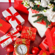Christmas gifts in red boxes on a red background — Stock Photo