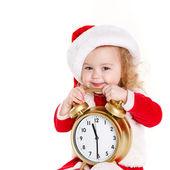Barnet håller närvarande bär santa hatt isolerad på vit — Stockfoto