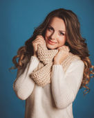 Girl in a white sweater with scarf — Stock Photo