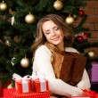 Girl with gifts under the Christmas tree — Stock Photo