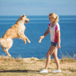 Young woman, labrador dog, sea — Stock Photo #36966971
