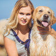 Young woman, labrador dog, sea — Foto Stock