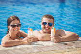 Young family resting on a tropical resort — Stock Photo