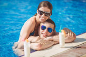Young family on vacation in the tropics, the sea, pool, blue water — Photo