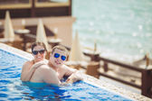 Young family on vacation in the tropics, the sea, pool, blue water — Stok fotoğraf