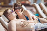 Young family on vacation in the tropics, the sea, pool, blue water — ストック写真