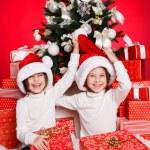 Happy teen sisters decorating Christmas tree — Stock Photo #37213393