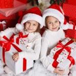 Happy teen sisters decorating Christmas tree — Stock Photo #37213401
