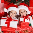 Happy teen sisters decorating Christmas tree — Stock Photo #37213403
