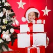 Happy teen sisters decorating Christmas tree — Stock Photo #37213429