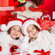 Happy teen sisters decorating Christmas tree — Stock Photo #37213443