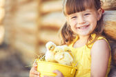 Little girl with chickens — Stock Photo