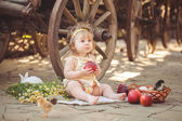 Little girl playing with rabbit in the village. Outdoor. Summer portrait. — Stock Photo