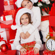 Portrait of Santa hat Christmas girls holding christmas gifts smiling happy and excited. Cute beautiful santa children on red background. — Stock Photo #37669777