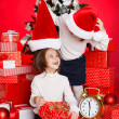 Portrait of Santa hat Christmas girls holding christmas gifts smiling happy and excited. Cute beautiful santa children on red background. — Stock Photo #37669801