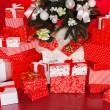 Christmas background with a red ornament, red gift boxes, red christmas balls — Stock Photo #37673695