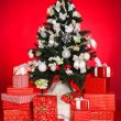 Christmas background with a red ornament, red gift boxes, red christmas balls — Stock Photo #37673699