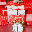 Christmas background with a red ornament, red gift boxes, red christmas balls — Stock Photo #37673705