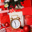 Christmas background with a red ornament, red gift boxes, red christmas balls — Stock Photo #37673721