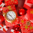 Christmas background with a red ornament, red gift boxes, red christmas balls — Stock Photo #37673723