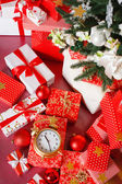 Christmas background with a red ornament, red gift boxes, red christmas balls — Stock Photo