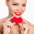 Portrait of Beautiful gorgeous woman with glamour bright makeup and red heart in hand — Stock Photo #37852503