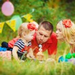 Family celebrating birthday party in green park outdoors — Stock Photo