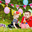 Family celebrating birthday party in green park outdoors — Stock Photo #37857531