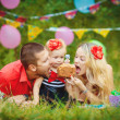 Family celebrating birthday party in green park outdoors — Stock Photo #37857535