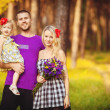 Family celebrating birthday party in green park outdoors — Stock Photo #37857545