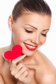 Portrait of Beautiful gorgeous woman with glamour bright makeup and red heart in hand — Stock Photo