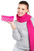 Portrait of cute young woman holding gift box in her hand — Stock Photo